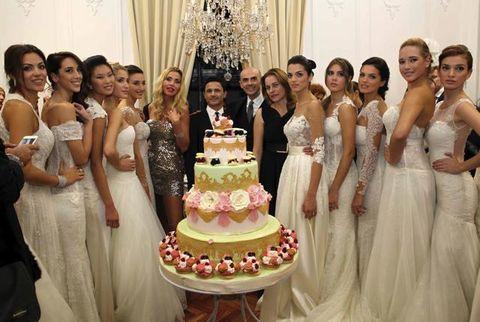 Clothing, Smile, Dress, Cake, Event, Dessert, Baked goods, Bridal clothing, Wedding dress, Happy,