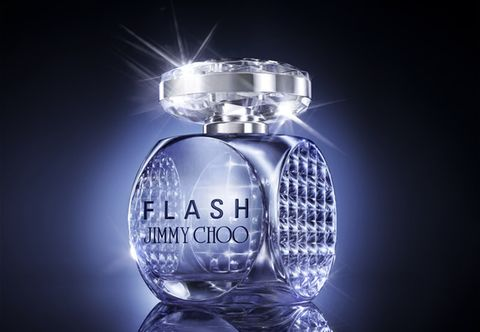 Perfume, Light, Glass, Trophy, Circle, Transparent material, Light bulb, Silver, Advertising, Still life photography,