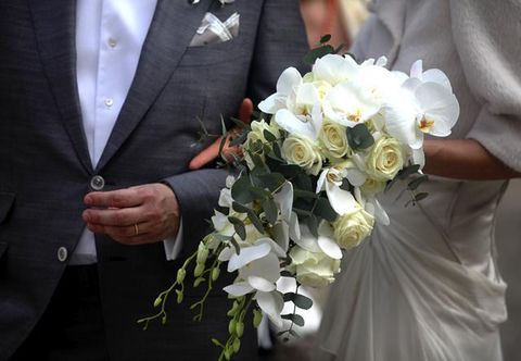 Clothing, Petal, Coat, Bouquet, Collar, Flower, Outerwear, Suit, Formal wear, Dress shirt,
