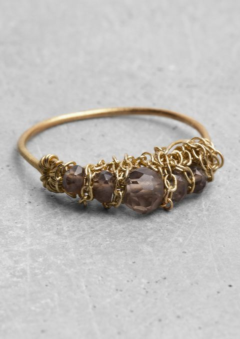 Jewellery, Fashion accessory, Amber, Metal, Body jewelry, Natural material, Fashion, Tan, Bracelet, Beige,