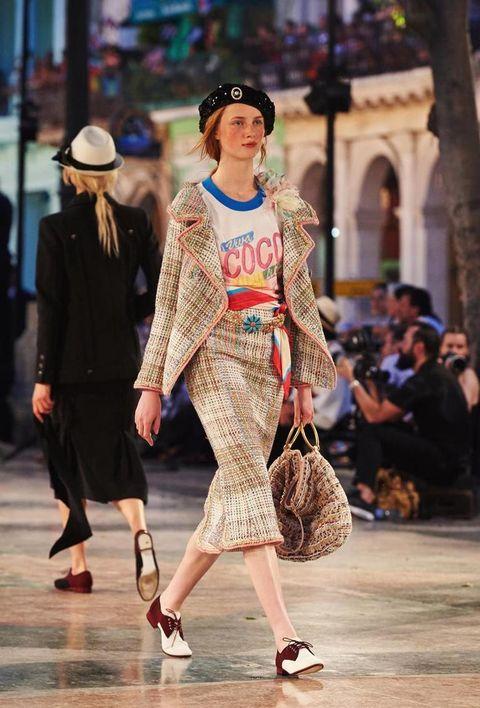 Footwear, Hat, Shoulder, Outerwear, Fashion show, Style, Street fashion, Runway, Fashion accessory, Headgear,