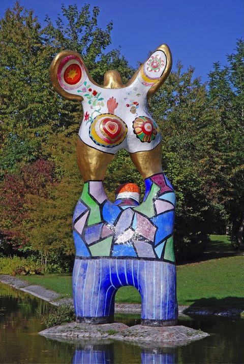 Sculpture, Art, Garden, Lawn ornament, Spring, Reflection, Statue, Nonbuilding structure, Visual arts, Environmental art,