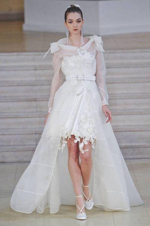 Clothing, Sleeve, Dress, Shoulder, Bridal clothing, Shoe, Textile, Photograph, Joint, White,