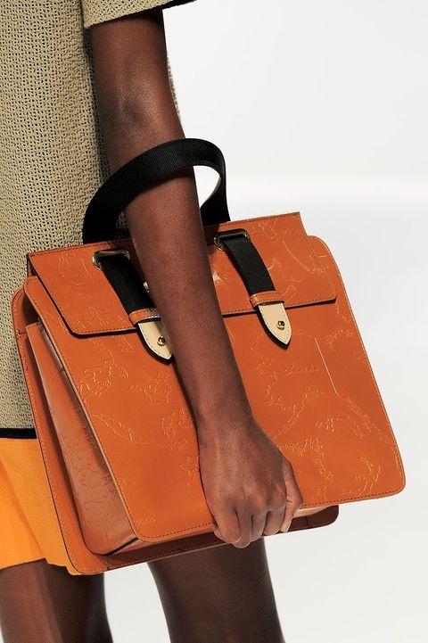 Brown, Textile, Bag, Joint, Orange, Tan, Fashion, Leather, Wrist, Pocket,