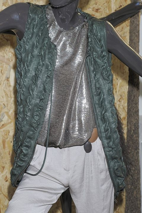 Textile, Costume accessory, Denim, Pocket, Street fashion, Staple food, Italian food, Button, Sculpture,