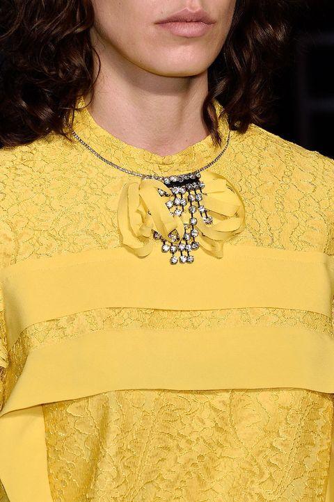 Clothing, Yellow, Fashion accessory, Jewellery, Neck, Body jewelry, Metal, Necklace, Embellishment, Fashion design,