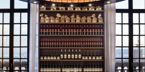 Table, Furniture, Restaurant, Glass, Fixture, Barware, Daylighting, Drink, Bottle, Alcoholic beverage,