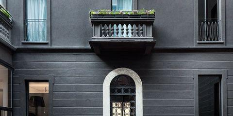 Architecture, Property, Facade, Building, Real estate, Fixture, Door, Balcony, Material property, Symmetry,