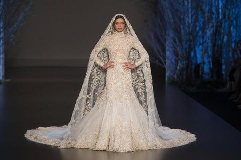 Clothing, Textile, Dress, Bridal clothing, Gown, Wedding dress, Veil, Fashion, Beauty, Embellishment,