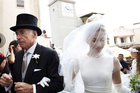 Clothing, Bridal veil, Veil, Hat, Photograph, Bridal clothing, Outerwear, Coat, Suit, Formal wear,