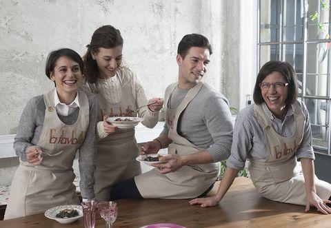 Head, Smile, Happy, Dishware, Serveware, Plate, Dessert, Wood flooring, Apron, Family,