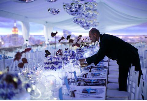 Blue, Tablecloth, Function hall, Purple, Decoration, Suit, Stemware, Drinkware, Ceiling, Champagne stemware,