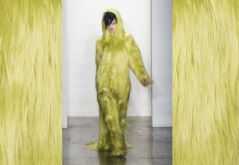 Yellow, Textile, Costume design, Costume, Fur, Artificial hair integrations, Fashion design, Natural material, Animal product, Haute couture,