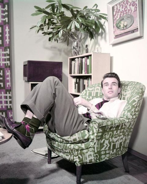 Comfort, Room, Furniture, Sitting, Purple, Shelf, Picture frame, Home, Display device, Living room,