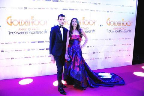 Coat, Trousers, Dress, Flooring, Outerwear, Purple, Formal wear, Suit, Carpet, One-piece garment,