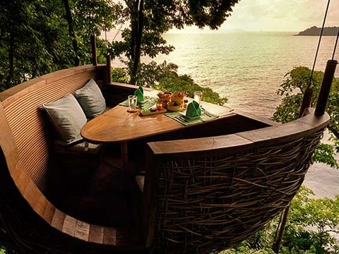 Wood, Table, Outdoor furniture, Outdoor table, Furniture, Hardwood, Coffee table, Couch, Restaurant, Resort,