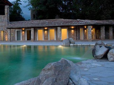 Rock, Real estate, Reflection, Resort, House, Bedrock, Home, Resort town, Boulder, Villa,