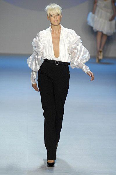 Clothing, Leg, Fashion show, Sleeve, Human body, Shoulder, Runway, Joint, Outerwear, Fashion model,