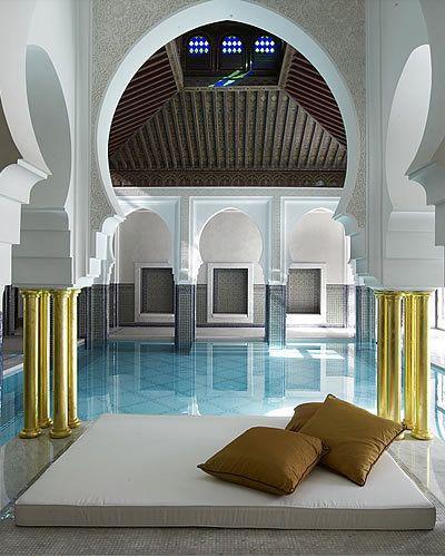 Interior design, Architecture, Room, Floor, Ceiling, Arch, Arcade, Throw pillow, Column, Turquoise,