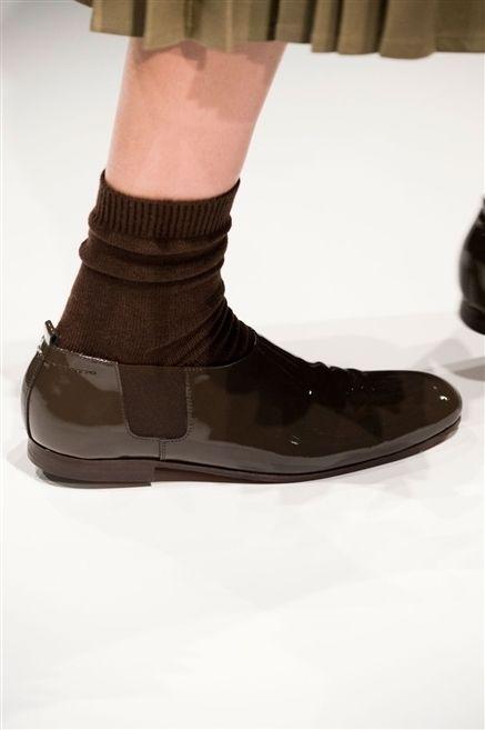 Brown, Human leg, Fashion, Tan, Beige, Walking shoe, Fashion design, Sock, Ankle, Costume accessory,