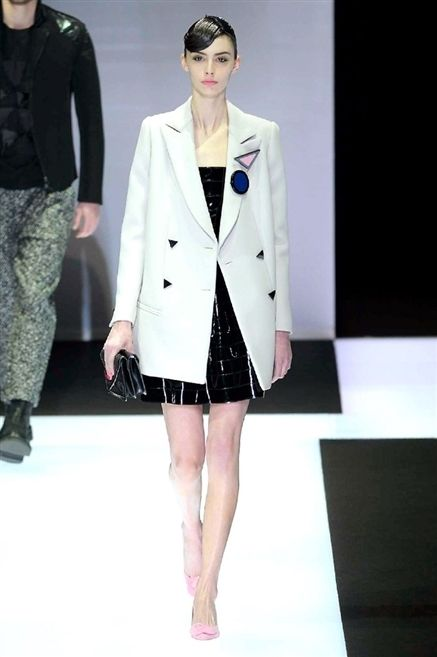 Clothing, Sleeve, Shoulder, Fashion show, Coat, Joint, Outerwear, Camouflage, Fashion model, Collar,