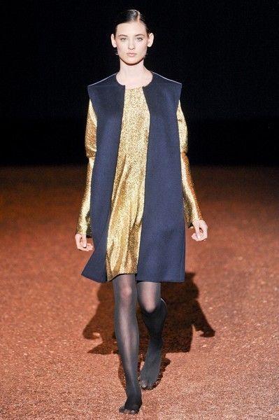 Clothing, Shoulder, Shoe, Human leg, Fashion show, Joint, Outerwear, Dress, Style, Runway,