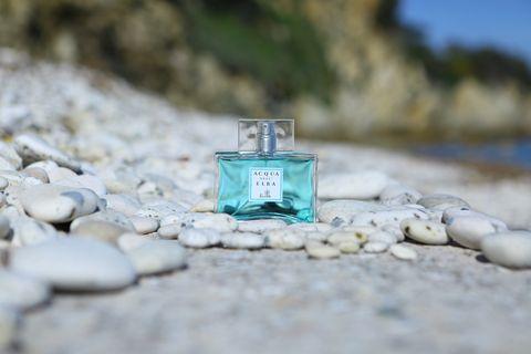 Perfume, Fluid, Liquid, Rock, Pebble, Aqua, Teal, Still life photography, Bedrock, Gravel,