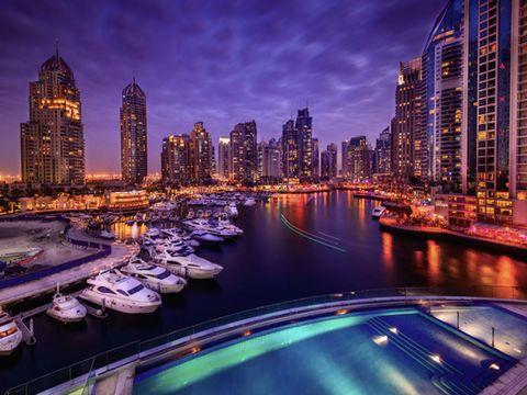 Body of water, Metropolitan area, Tower block, City, Metropolis, Urban area, Watercraft, Cityscape, Waterway, Reflection,