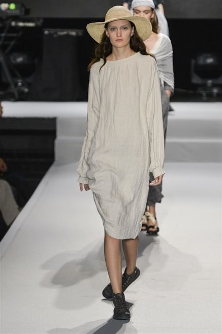 Clothing, Footwear, Fashion show, Shoulder, Human leg, Runway, Joint, Dress, Fashion model, Hat,