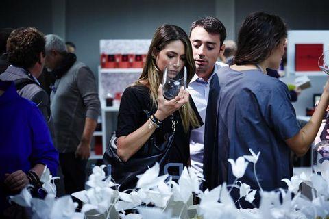 Hair, Arm, Interaction, Conversation, Artificial flower, Customer, Watch,