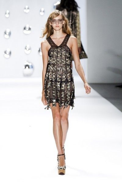 Clothing, Fashion show, Dress, Shoulder, Human leg, Joint, Runway, Fashion model, One-piece garment, Style,