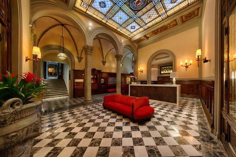 Lighting, Interior design, Floor, Room, Ceiling, Couch, Flooring, Furniture, Interior design, Hall,