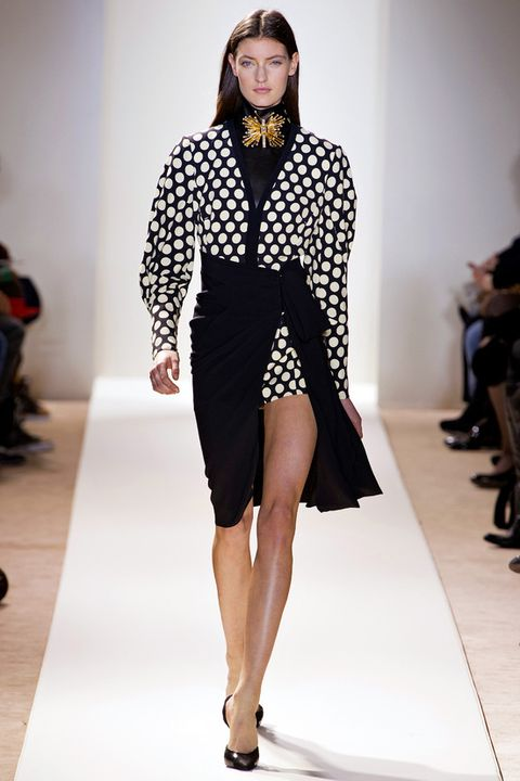 Footwear, Leg, Fashion show, Human leg, Shoulder, Runway, Shoe, Joint, Outerwear, Fashion model,