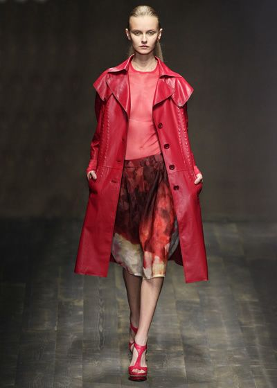 Clothing, Footwear, Sleeve, Fashion show, Textile, Red, Outerwear, Style, Runway, Fashion model,
