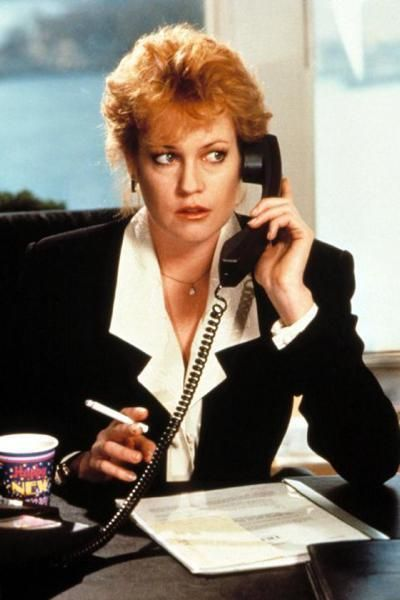 Hairstyle, Jewellery, Blazer, Red hair, Blond, Cup, White-collar worker, Layered hair, Necklace, Hair coloring,