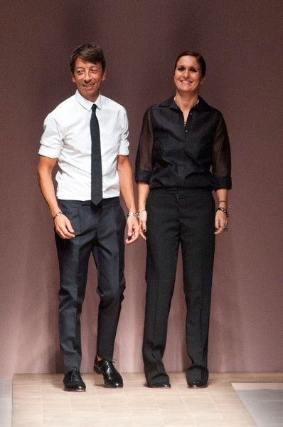 Leg, Dress shirt, Collar, Sleeve, Trousers, Suit trousers, Standing, Shirt, Joint, Formal wear,