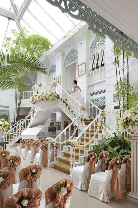 Petal, White, Dress, Bridal clothing, Stairs, Real estate, Wedding dress, Tradition, House, Bride,