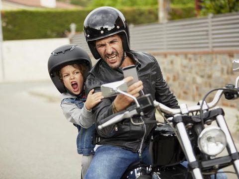 Motorcycle, Nose, Helmet, Outerwear, Personal protective equipment, Sports gear, Motorcycle helmet, Fender, Jacket, Motorcycle accessories,