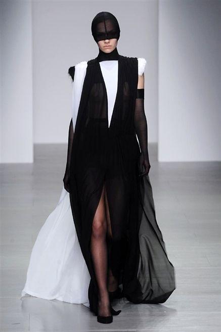 Floor, Style, Formal wear, Flooring, Dress, Costume accessory, Costume design, Fashion, Black, Fashion model,