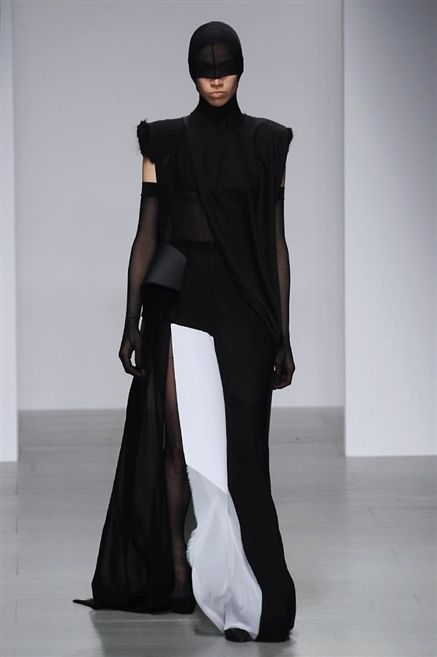 Cap, Shoulder, Floor, Outerwear, Style, Flooring, Formal wear, Fashion, Black, Street fashion,
