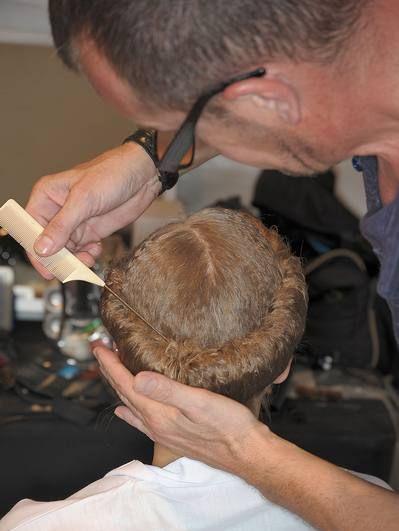 Hair, Head, Ear, Hairstyle, Mammal, Beauty salon, Hairdresser, Barber, Wrist, Facial hair,