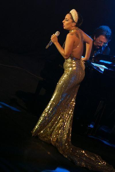 Microphone, Audio equipment, Music, Entertainment, Music artist, Performing arts, Dress, Artist, Singing, Performance,