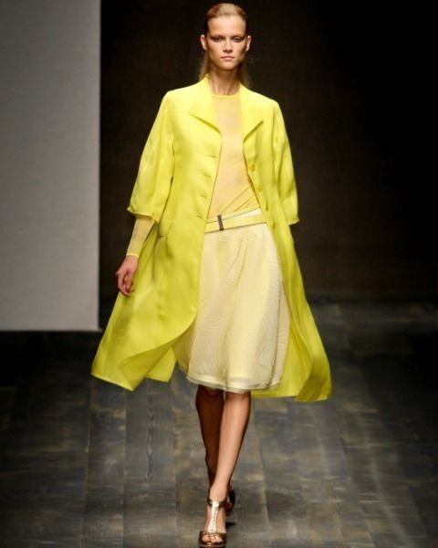 Clothing, Footwear, Yellow, Sleeve, Human body, Shoulder, Fashion show, Joint, Outerwear, Style,