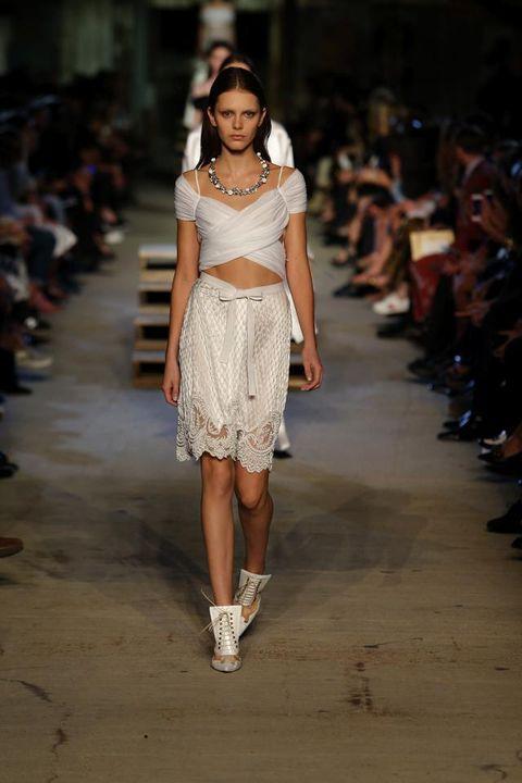 Brown, Shoulder, Joint, Fashion show, Human leg, Style, Waist, Runway, Street fashion, Fashion model,