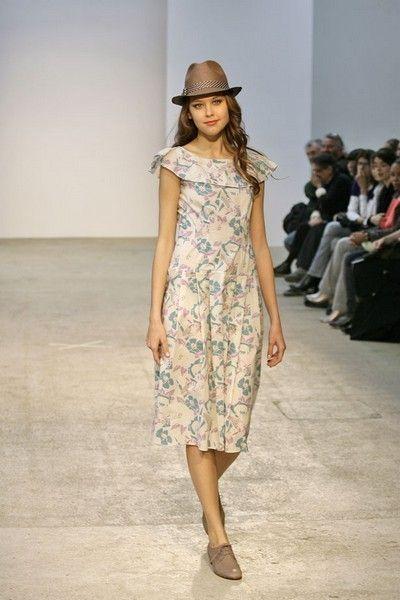 Clothing, Footwear, Brown, Shoe, Shoulder, Fashion show, Dress, Joint, Hat, One-piece garment,
