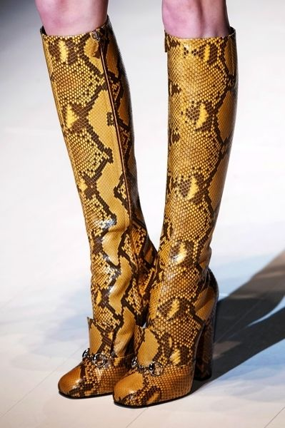 Brown, Pattern, Fashion, Visual arts, Fashion design, Knee-high boot, Woodwind instrument,