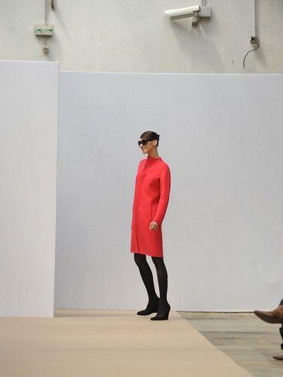 Human body, Shoulder, Joint, Wall, Knee, Street fashion, Light fixture, Bird, Fashion design, Electrical supply,