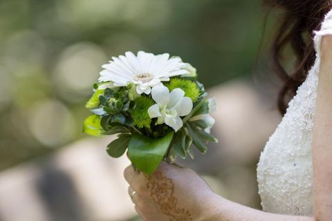 Petal, Flower, People in nature, Flowering plant, Cut flowers, Bouquet, Wedding ceremony supply, Artificial flower, Ceremony, Bride,