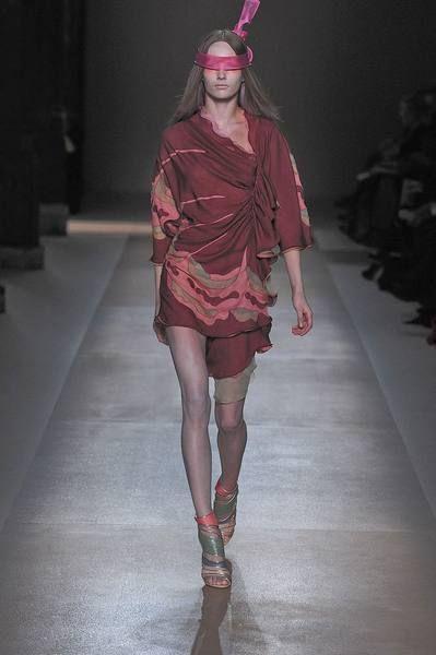 Clothing, Fashion show, Human leg, Runway, Dress, Style, Fashion model, Fashion, Headpiece, One-piece garment,