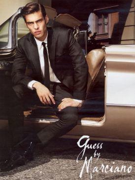 Trousers, Shoe, Sitting, Photograph, Comfort, Collar, Formal wear, Style, Jacket, Blazer,